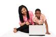 Two cute kids having fun on laptop