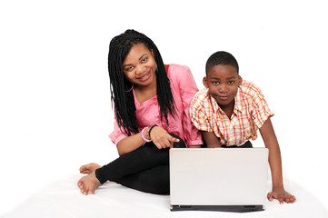 Two cute kids having fun on laptop