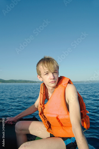 man driving a speedboat
