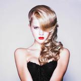 Beautiful blond woman with elegant black dress