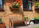 An English back Garden with Bench and Flower basket
