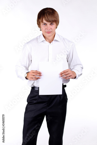 Young man displaying empty billboard, blank on white background