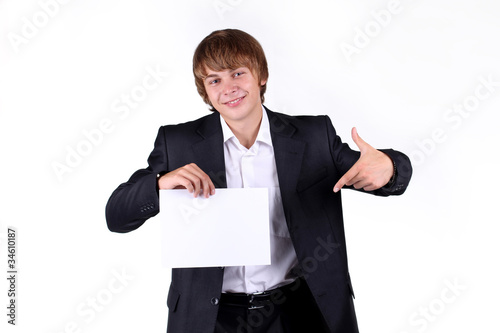 Portrait of a smiling young business man holding a blank billboa