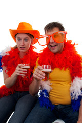 Two Dutch soccer fans over white background