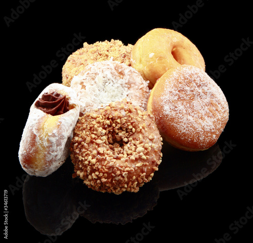 Assorted donuts on black