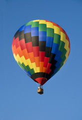 Colorful hot-air balloon against blue sky