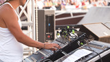sound control engineer in outdoor concert event
