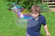 Boy Making Large Bubble