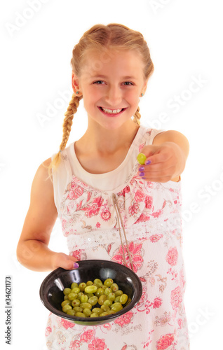 Attractive girl offering fresh grapes
