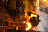 Smelting metal in metallurgical plant. Liquid iron from ladle