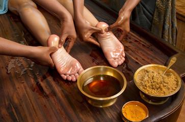 traditional indian ayurvedic oil foot massage