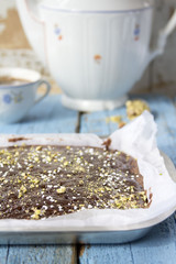Brownies with pistachios and sugar pearls in tin