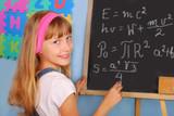 genius schoolgirl writing on blackboard poster