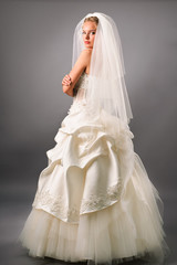 attractive young bride under veil in studio