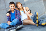 Two roller skaters
