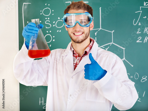 Man chemistry student with flask.