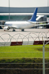 Airport security, razor wire soft focus view
