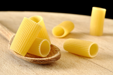 Rigatoni pasta on a wooden spoon