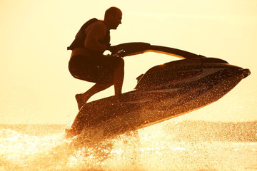man jumps on the jetski