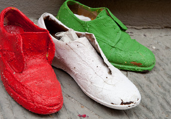 Old italian shoes colored in italian colors