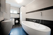 Modern bathroom with black tiles - 34648398