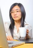 Chinese businesswoman drinking coffee