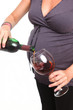 Pregnant Woman Pouring Herself a Drink