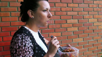 Woman eating at the balcony at lunch break - 1080HD