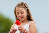 Family - Happy girl with corn poppy in summer