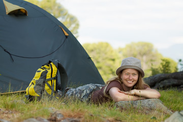 Happy  tourist in front  tent