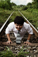 a businessman walking on a railway