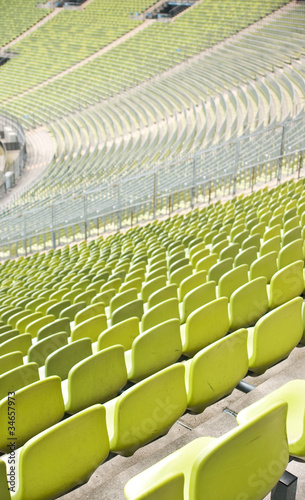 fototapeta na ścianę Empty plastic seats at stadium, open door sports arena
