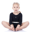 Gymnast girl sitting in butterfly pose