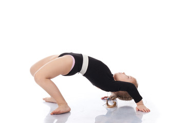 Girl child performing backward bend gymnastics