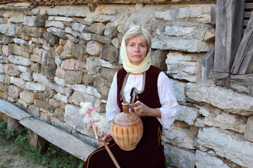 Woman dressed in antique Bulgarian folk costume
