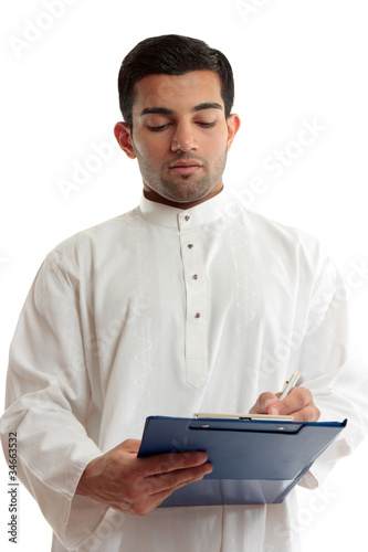 Ethnic business man writing