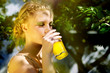 girl drinking orange juice