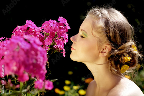 Girl and pink phlox flowers