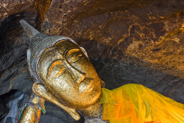 Buddha image in the cave