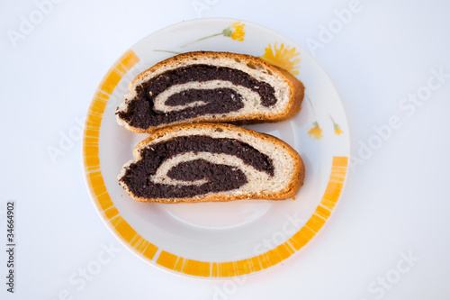 Two pieces of strudel with poppy seeds
