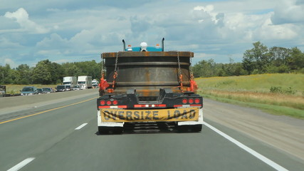Truck with oversized load going down the highway. Ontario.