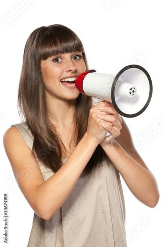 Portrait of beautiful female proclaiming into the loudspeaker