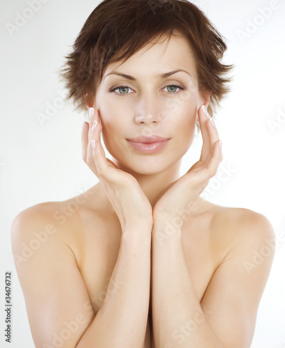 Beautiful Young Woman touching her Face. Skincare