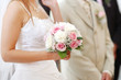 Bride holding bride bouquet during wedding ceremony