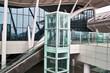 Glass elevator and escalator