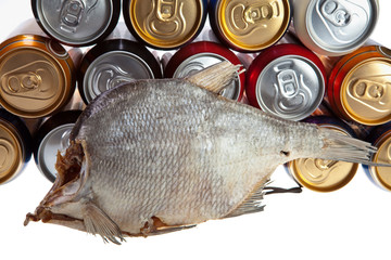 Dried fish and beer on a white background