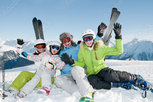 Ski, snow, sun and fun - happy family on ski