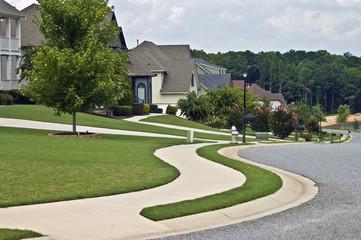 Sidewalk and Homes in Modern Neighborhood