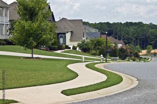 Sidewalk and Homes in Modern Neighborhood