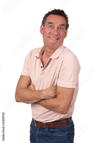 Attractive Man Making Silly Funny Smile with Arms Folded